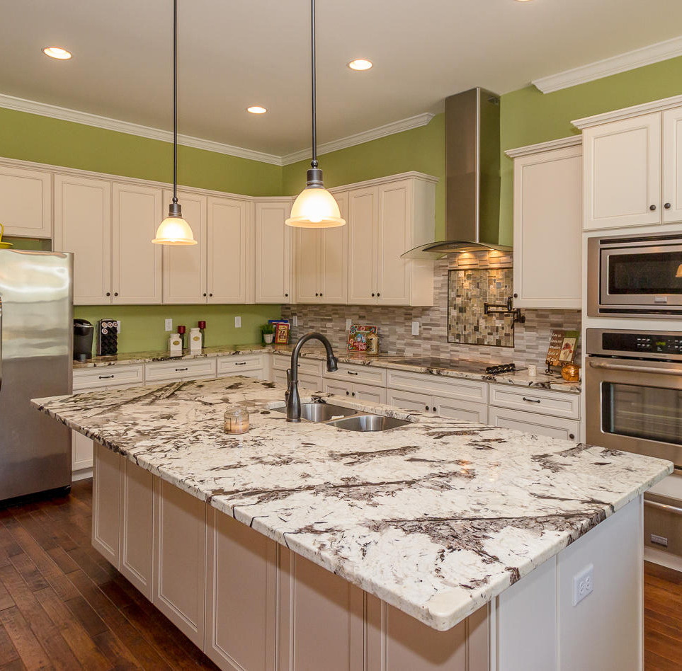Custom Kitchen And Island With Stainless Steel Range Hood Augusta S And H  Construction Custom Home