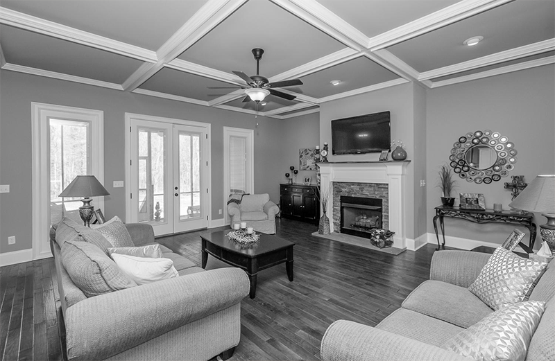 Black and white great room coffered ceiling custom home Augusta S and H Construction custom home builder Augusta GA