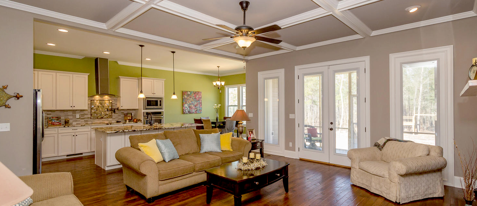 Open concept family room and kitchen Augusta S and H Construction custom home builder Augusta GA